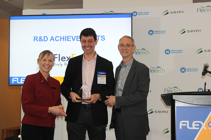 FlexEnable's Strategy Director Dr. Paul Cain collects the FLEXI Award